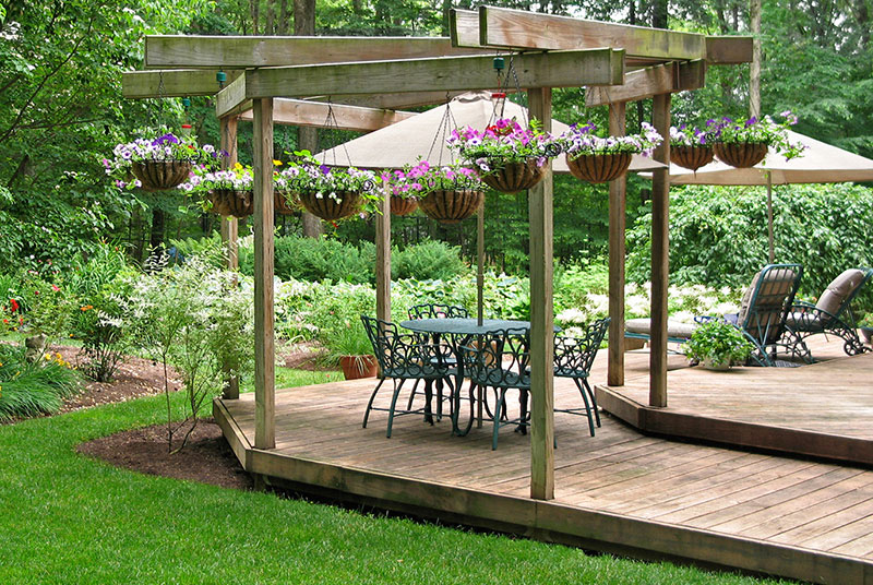 Hanging baskets from sleeper wooden deck